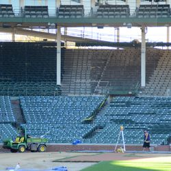 12:59 p.m. A view inside the ballpark at Gate Q, showing the removal of grandstand seats along the third base line -