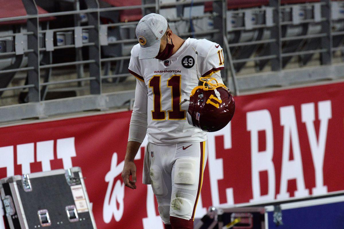 Washington Football Team quarterback Alex Smith (11) walks along the sideline against the San Francisco 49ers during the second half at State Farm Stadium.