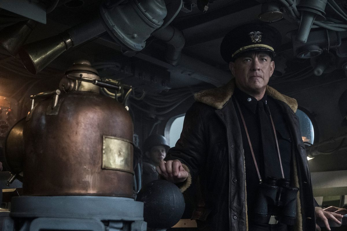 hanks stands inside a warship
