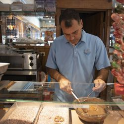 Owner John Manchester makes chocolate-covered pretzels at Windy City Sweets in Boystown.    Colin Boyle/Sun-Times