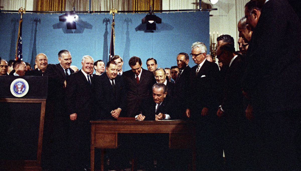 President Lyndon B. Johnson signing the 1967 Clean Air Act in the East Room of the White House.
