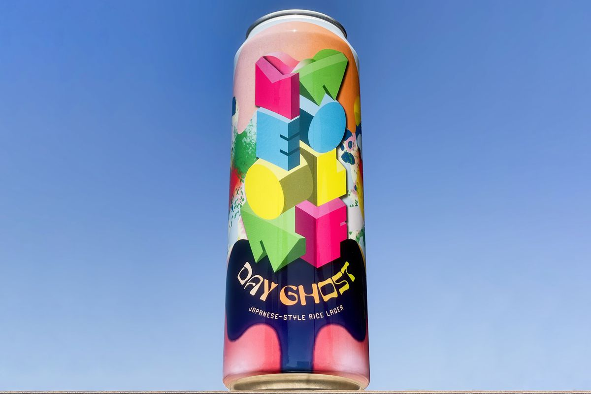 a can of beer with pink, yellow, blue and green on it