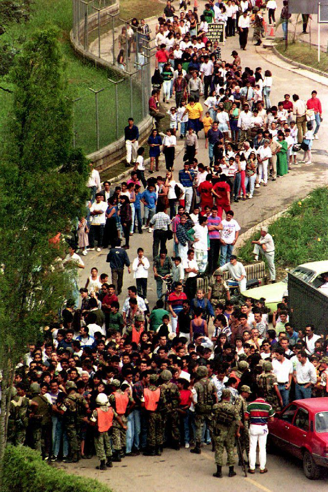 People outside Escobar's funeral