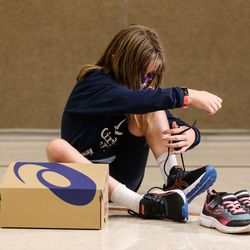 Mountain View Elementary fifth grade student Savannah Averit tries on new shoes donated by the Larry H. & Gail Miller Family Foundation on Thursday, Sept. 16, 2021, at the school in Salt Lake City. The foundation donated 1,000 pairs of Asics running shoes to underserved girls participating in the Girls on the Run Utah character development program.