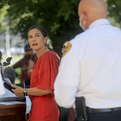 Salt Lake City Mayor Erin Mendenhall looks back at Police Chief Mike Brown as she talks about updates to the city's police policies — including de-escalation efforts, use of force, body cameras and consent to search — during a press conference outside of the City-County Building in Salt Lake City on Monday, Aug. 3, 2020.