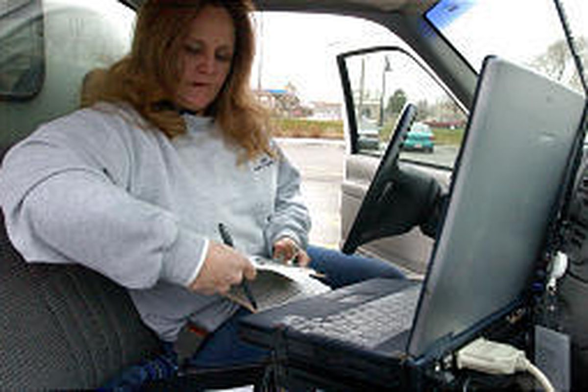Utah Department of Agriculture inspector Mitzi Hansen writes up a report for a retail store after finishing a store inspection.
