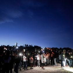 People gather for a vigil for Priscilla Bienkowski and Sophia Hernandez on the west side of Utah Lake on Saturday, May 9, 2020. The two teenagers have been missing since going to the lake on Wednesday.