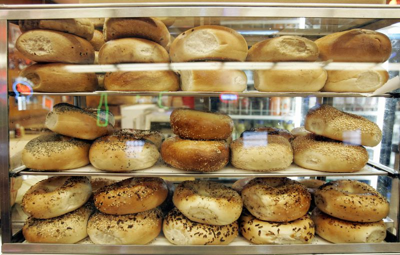 A display case filled with bagels