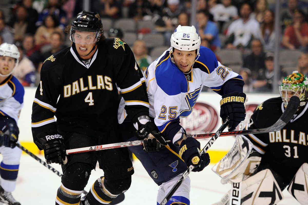 Apr 7, 2012; Dallas, TX, USA; Dallas Stars defenseman Brenden Dillon (4) defends against St. Louis Blues right wing Chris Stewart (25) during the first period at the American Airlines Center. Mandatory Credit: Jerome Miron-US PRESSWIRE