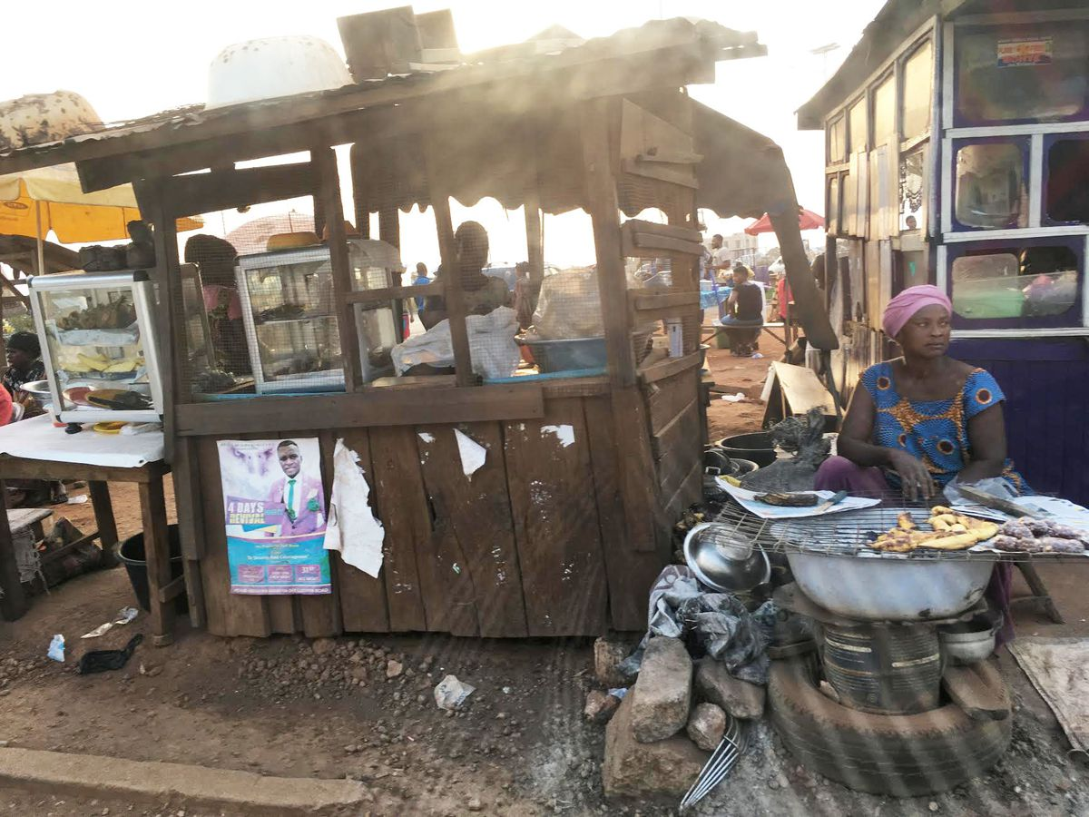 A woman sells suya, spicy grilled shish kebab, at the side of the road in Kumasi, Ghana, where roadside vending of everything from food to clothes is the only way many survive.   Maudlyne Ihejirika/Sun-Times