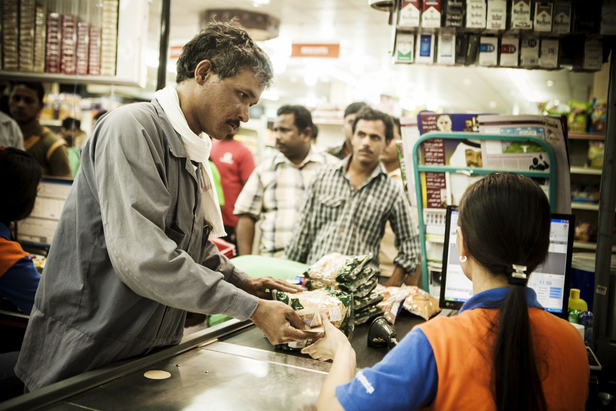 Migrant workers at food markets in Doha's Industrial Area, 2011.