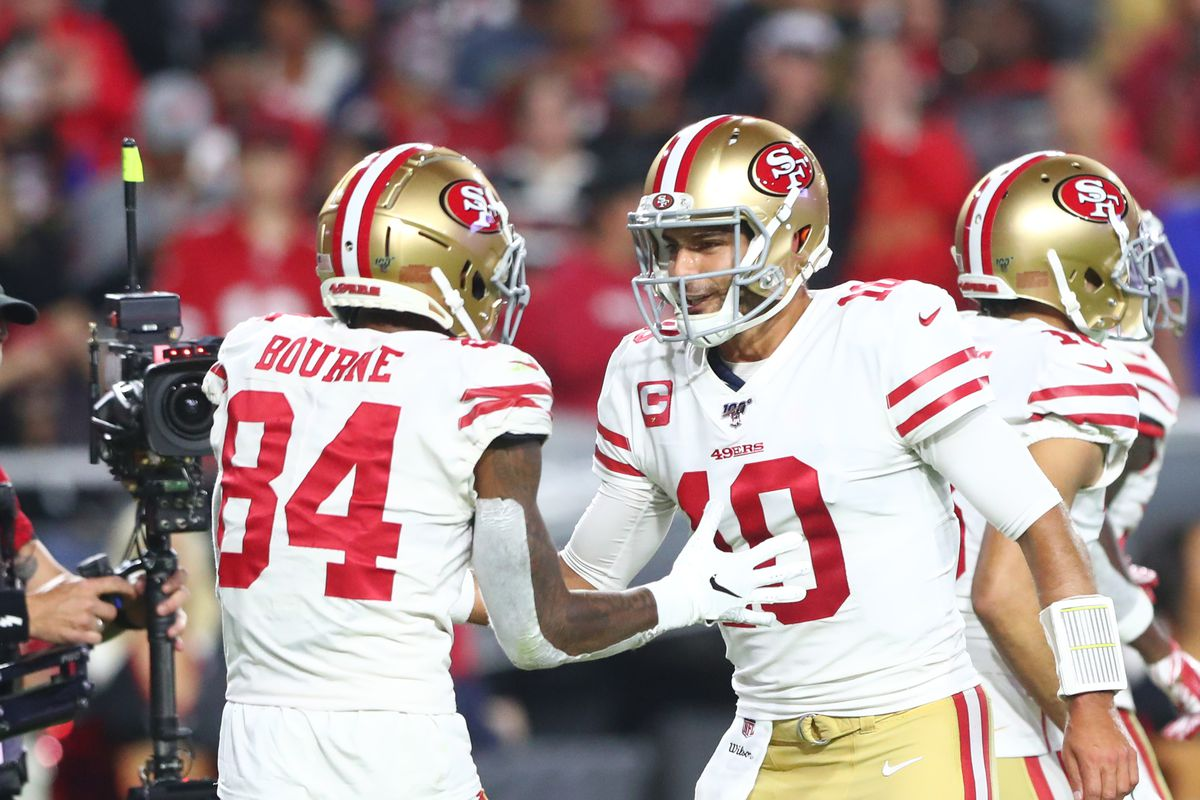 San Francisco 49ers quarterback Jimmy Garoppolo celebrates a touchdown with wide receiver Kendrick Bourne in the first half against the Arizona Cardinals at State Farm Stadium.