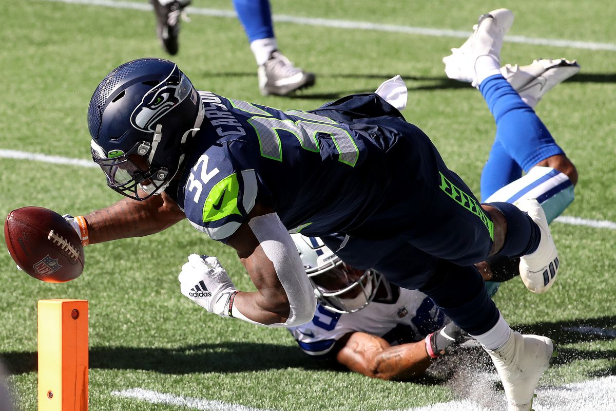 Chris Carson of the Seattle Seahawks dives out of bounds just short of the end zone against the Dallas Cowboys during the second quarter in the game at CenturyLink Field on September 27, 2020 in Seattle, Washington.