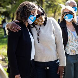 Salt Lake City Mayor Erin Mendenhall, left, embraces Darlene McDonald, a member of the city's Commission on Racial Equity in Policing, before a press conference at the International Peace Gardens in Salt Lake City on Tuesday, April 20, 2021. The group gathered to share their reaction to the guilty verdicts returned in the trial of former police officer Derek Chauvin in Minneapolis.