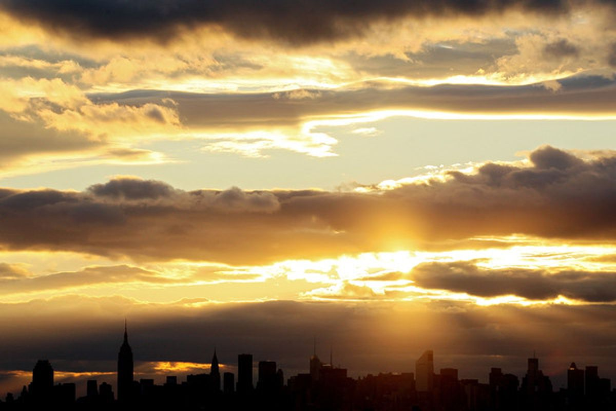 NEW YORK:  The sun sets over the Manhattan skyline.  (Photo by Chris McGrath/Getty Images)