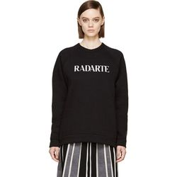 "<b>Rodarte</b> sweatshirt, <a href=""https://www.ssense.com/women/product/rodarte/black-burnout-radarte-crewneck-sweatshirt/113940"">$144</a>"