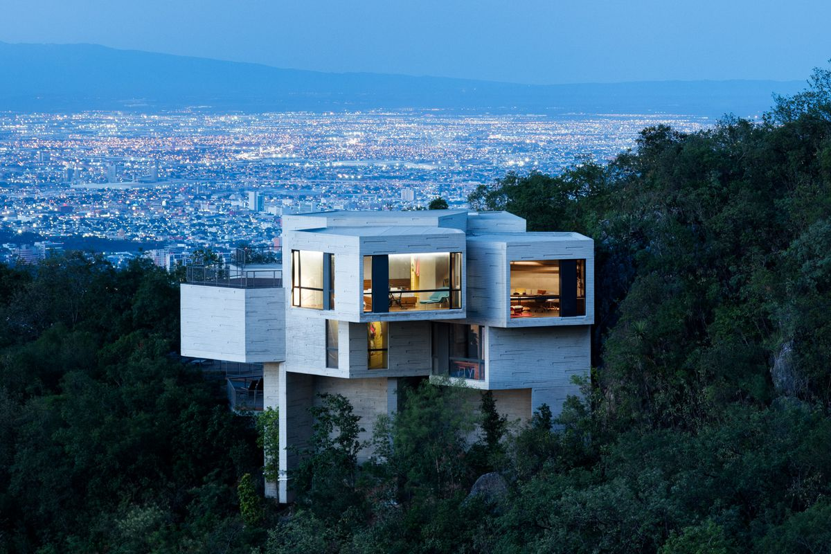cantilevered modern stunner nods to la's hillside homes - curbed