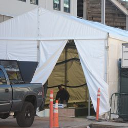 3:39 p.m. Netting for batting cages apparently being installed inside this tent -