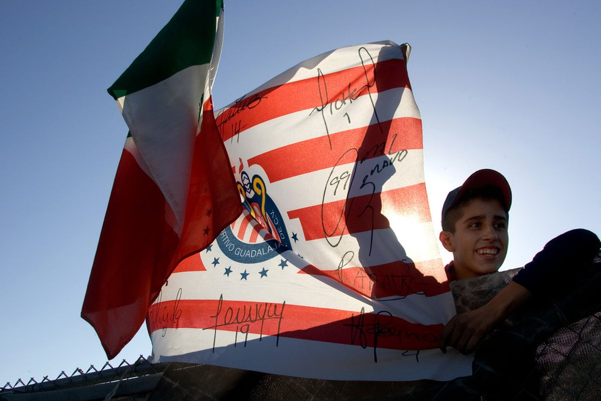 SAN DIEGO, CA - JULY 20:  A fan of CD Chivas waits for the team buses to arrive prior to the game against Real Madrid at Qualcomm Stadium on July 20, 2011 in San Diego, California. (Photo by Kent Horner/Getty Images)