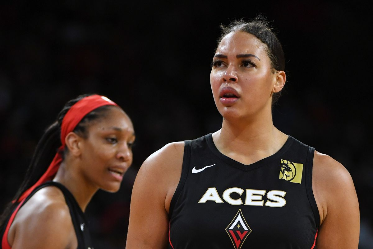A'ja Wilson and Liz Cambage of the Las Vegas Aces stand on the court during Game Three of the 2019 WNBA Playoff semifinals against the Washington Mystics at the Mandalay Bay Events Center on September 22, 2019 in Las Vegas, Nevada.