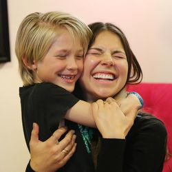 Actress Tatum Chiniquy hugs Beau Hansen in West Haven on Nov 20, 2016. Beau's sister Kennedy passed away in June 2014, and a book and a movie where Chiniquy plays Kennedy tells the story.