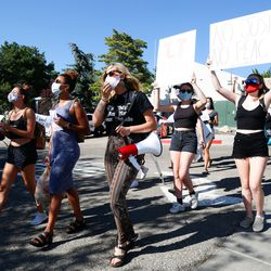 University of Utah students march along the road during a protest on the University of Utah campus in Salt Lake City on Thursday, Aug. 6, 2020. A small group of demonstrators gathered to protest the handling of the Lauren McCluskey case amid recent reports that a police officer showed explicit photos of the slain student to fellow officers.