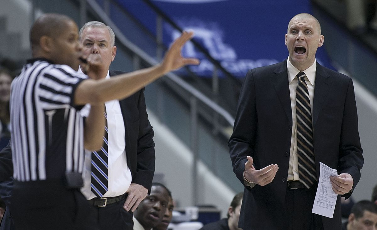 20130210 BYU's Head Coach Dave Rose and assistant coach Mark Pope yell at the referee that they had called a timeout as BYU and San Francisco play Saturday, Feb. 9, 2013 in the Marriott Center.