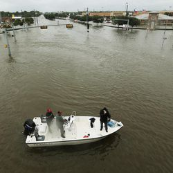 Volunteers search for stranded victims during Tropical Storm Harvey in Houston on Tuesday, Aug. 29, 2017.