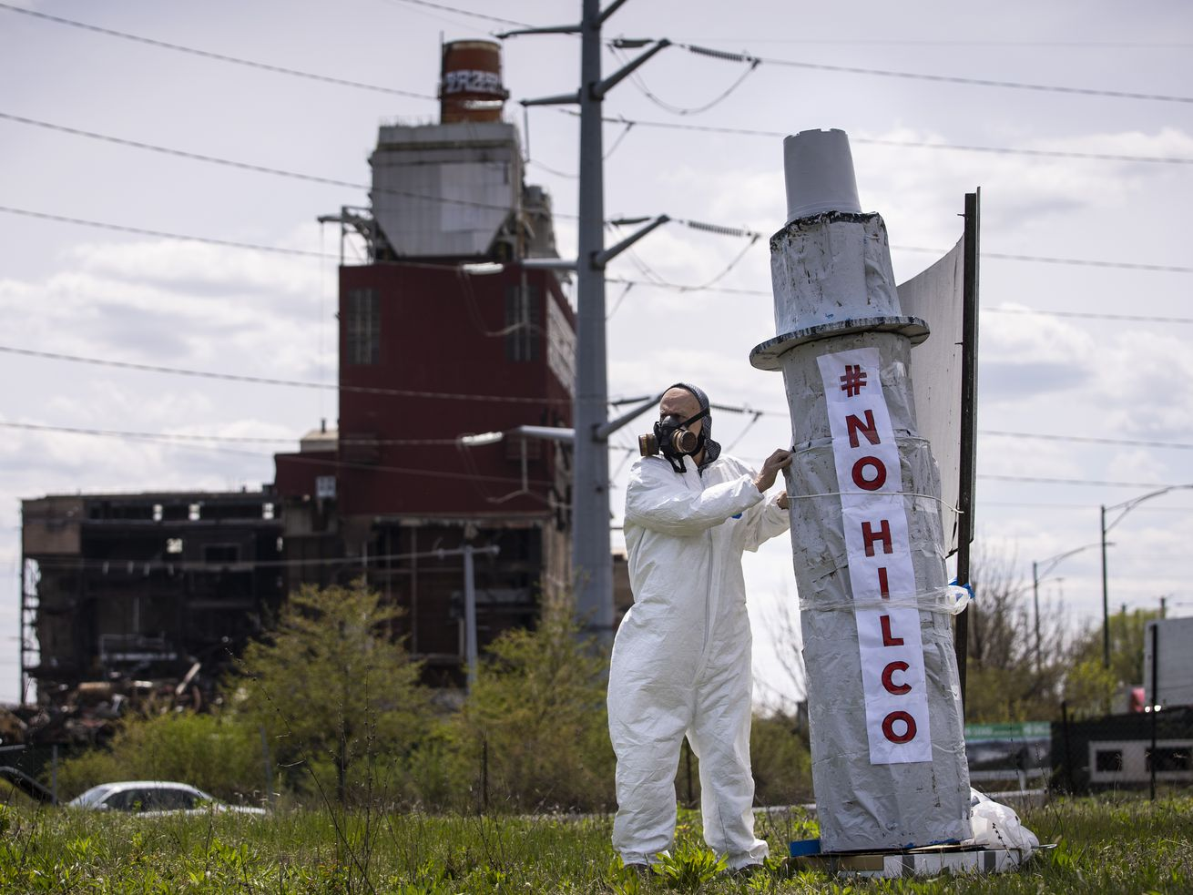Rafael Cervantes, 72, of Little Village, protests against Hilco near the site of the closed Crawford power plant near West 33rd Street and South Pulaski Road, Thursday afternoon, May 7, 2020. A subcontractor demolished a smokestack at the plant in April, bringing a giant plume of dust to the neighborhood, making it difficult to breathe during the coronavirus pandemic. | Ashlee Rezin Garcia/Sun-Times
