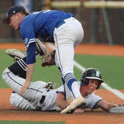 Dixie's Malcolm Bartholomew tags out Ridgeline's Miles Eck out on the rundown furing 4A baseball state playoff action at Salt Lake Community College in West Jordan on Wednesday, May 19, 2021. Dixie won 6-3.