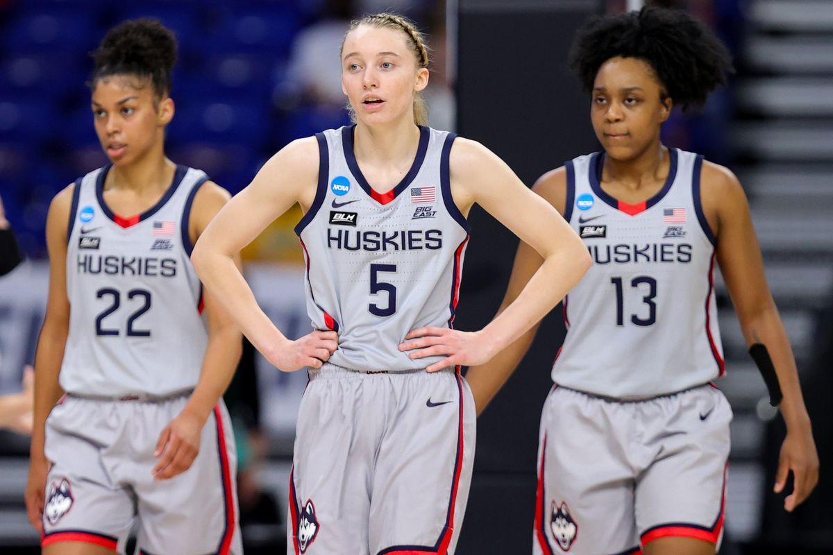 Evina Westbrook, Paige Bueckers, and Christyn Williams of the UConn Huskies walk down the court during the second half against the Baylor Lady Bears in the Elite Eight round of the NCAA Women's Basketball Tournament at the Alamodome on March 29, 2021 in San Antonio, Texas.