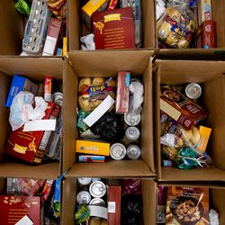 Boxes full of food wait to be distributed at Calvary Baptist Church in Salt Lake City on Saturday, Dec. 19, 2020.