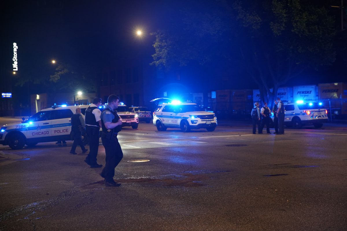 Police vehicles gather at the scene of an officer-involved crash