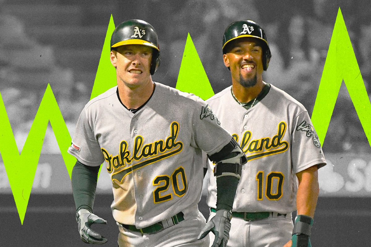 Marcus Semien and Mark Canah smile on their A's uniforms as they walk off the field.