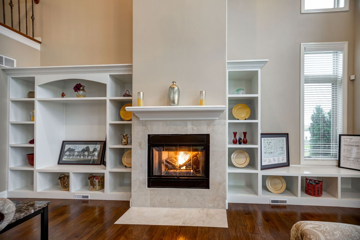 A fireplace and built-in shelves.