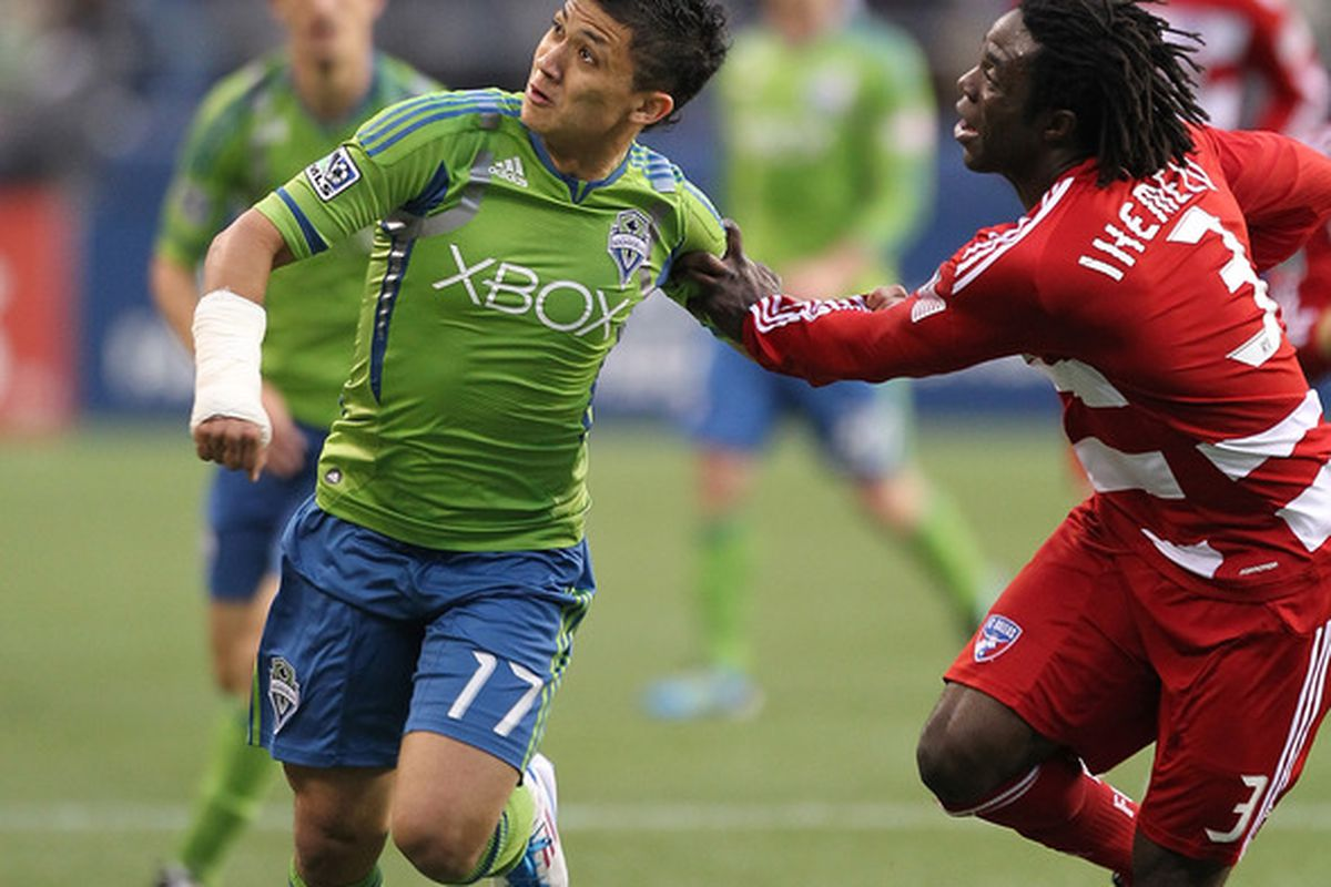 SEATTLE - MAY 25:  Fredy Montero #17 of the Seattle Sounders FC battles Ugo Ihemelu #3 of  FC Dallas at Qwest Field on May 25, 2011 in Seattle, Washington. FC Dallas defeated the Sounders 1-0. (Photo by Otto Greule Jr/Getty Images)