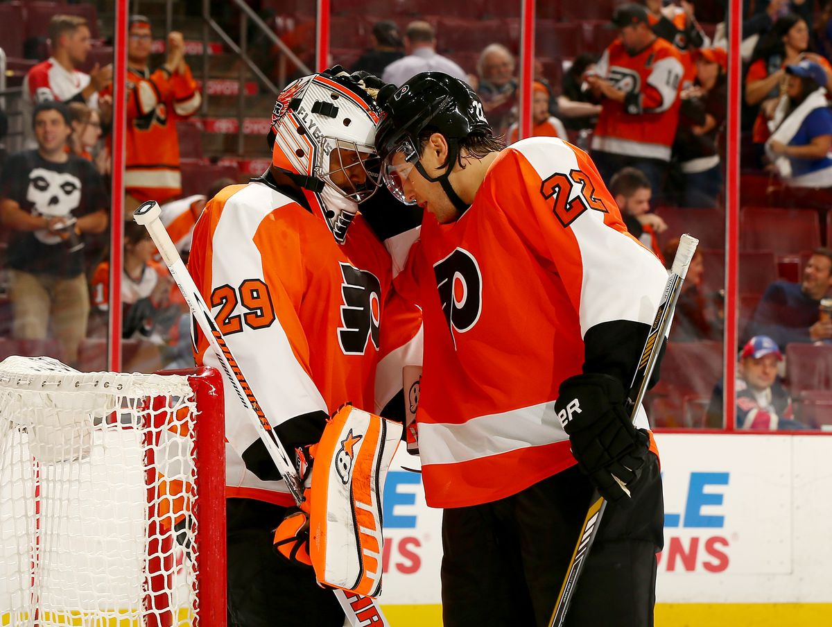 Ray Emery of the Philadelphia Flyers is celebrates the win with teammate Luke Schenn after the game against the New York Rangers on September 30, 2014 at the Wells Fargo Center in Philadelphia. The Philadelphia Flyers defeated the New York Rangers 4-2.