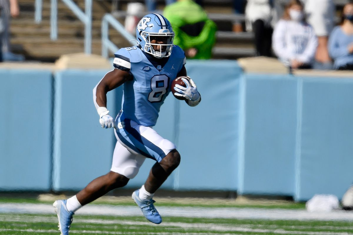 Michael Carter #8 of the North Carolina Tar Heels runs against the Wake Forest Demon Deacons during their game at Kenan Stadium on November 14, 2020 in Chapel Hill, North Carolina.