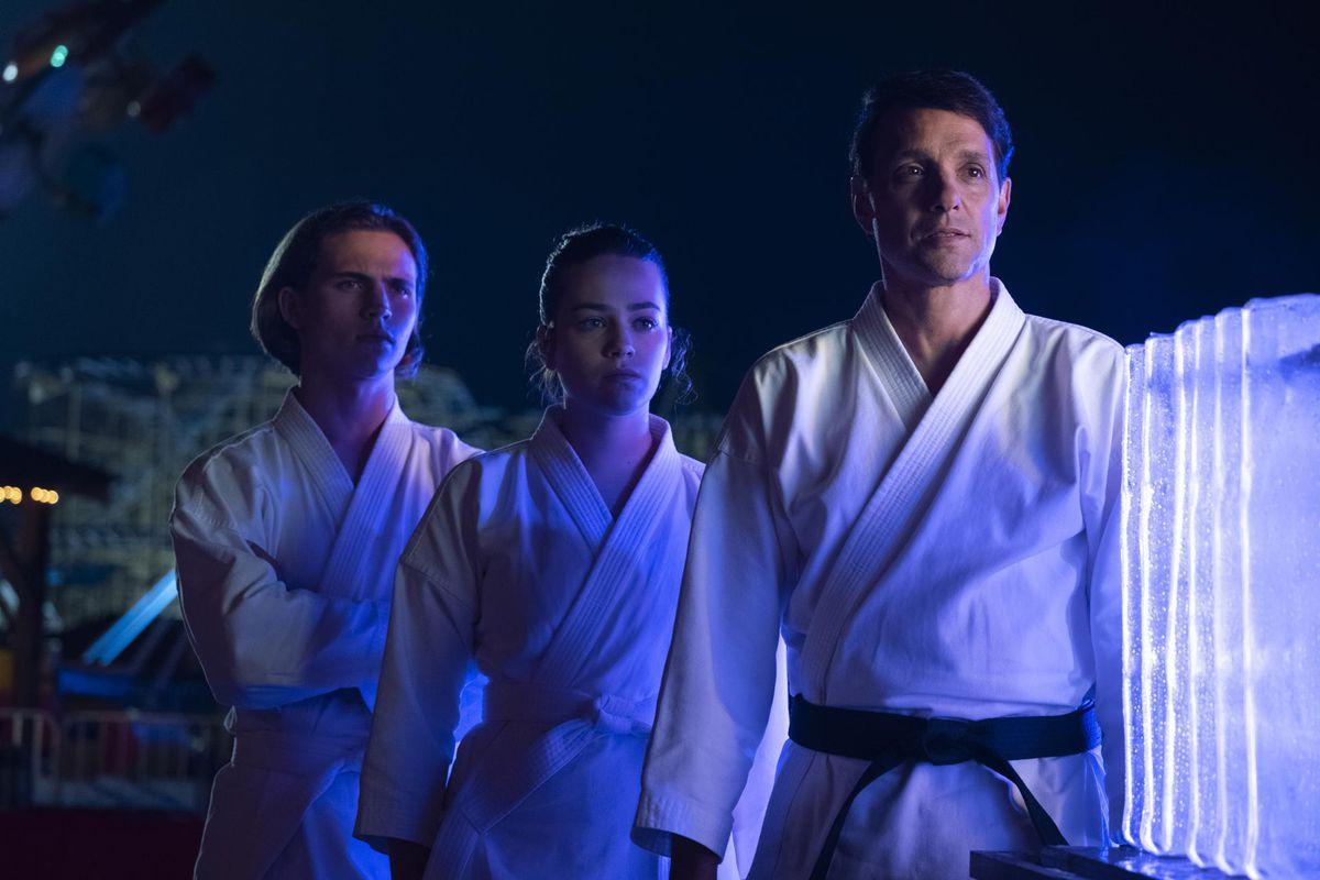 4e91b2b8 Miyagi-do's Robby (Tanner Buchanan), Samantha (Mary Mouser) and sensei  Daniel (Ralph Macchio). Overbrook Entertainment/YouTube Premium