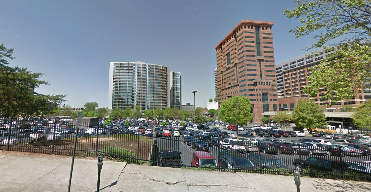 A massive surface parking lot, filling an entire Midtown block.