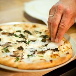 Bluehour gets seasonal with a ramps and morels pizza.