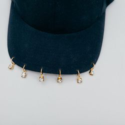 <b>Arielle De Pinto</b> Pierced Cap, $90