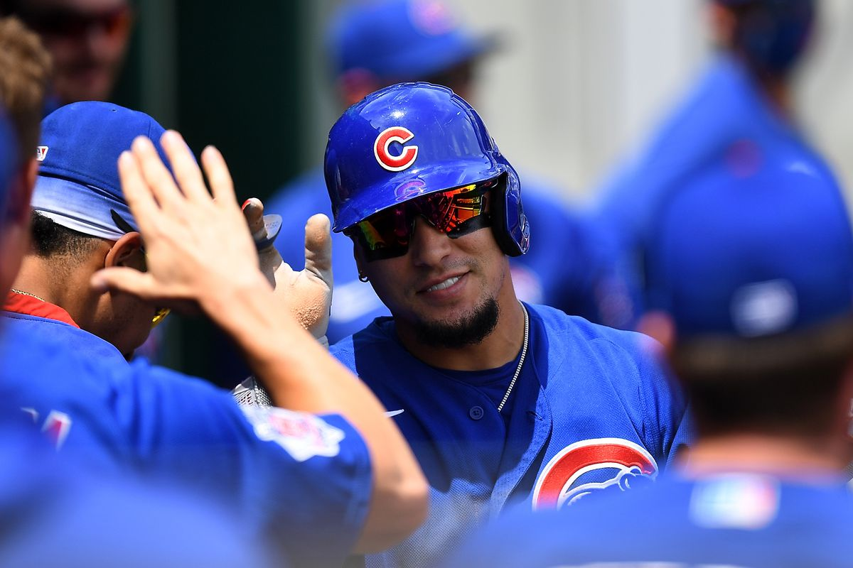The Cubs' Javier Baez celebrates with teammates after scoring during the third inning against the Pirates.