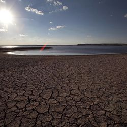 In this Sunday Aug. 7, 2011 file photo, the dried lake bed of Lake E.V. Spence is shown in Robert Lee, Texas. A new study has found a strong link between climate change and wildfire by studying lake-bottom sediments around the world.