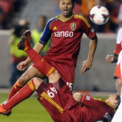 Real Salt Lake's Devon Sandoval kicks the ball backwards for a shot on goal as teammate çlvaro Sabor'o watches in the second half of the 2013 U.S. Open Cup against D.C. United at Rio Tinto Stadium on Tuesday, October 1, 2013.