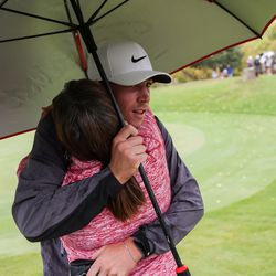 Jackson Rhees gets a hug from his mother, Lucilla Rhees, after he finished first in individual competition at the 5A boys state golf tournament at The Oaks at Spanish Fork in Spanish Fork on Tuesday, Oct. 5, 2021.