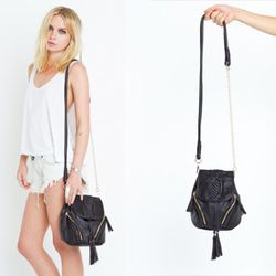 """Hot, rockin', not leather. <a href=""""http://www.shopnastygal.com/products/new/clothing//Chelsea-Bucket-Bag.html"""" rel=""""nofollow"""">Available at Nasty Gal for </a>"""