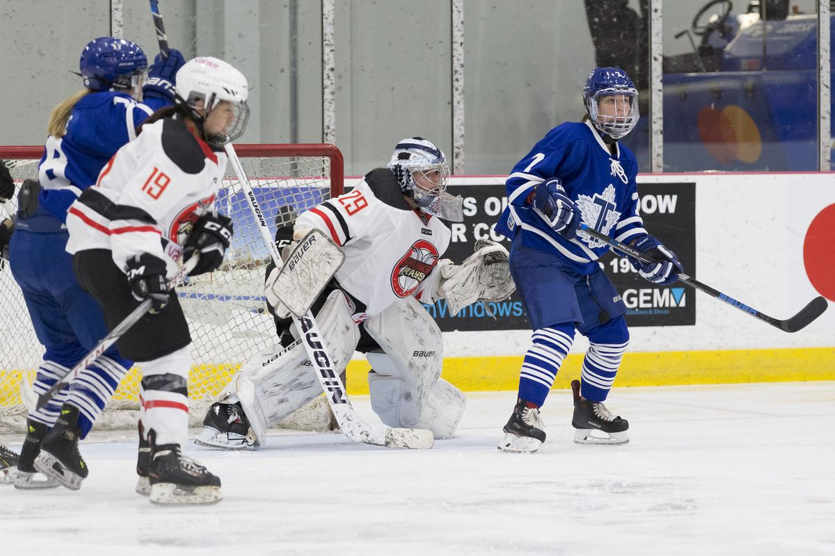 Vanke Rays player Hou Yue (#19) and goalie Elaine Chuli (29) in their inaugural CWHL game, October 28, 2017 against the Toronto Furies.