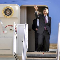 President Barack Obama waves from Air Force One at the Roswell International Air Center in Roswell, N.M., Wednesday, March 21, 2012.