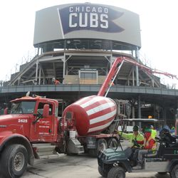 3:39 p.m. Concrete being delivered into the left-field bleachers -
